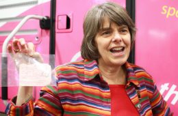 Mary Beth Tinker proudly holds the pink slip that summoned her to the office to be suspended for her black armband. Credit: Aysen Tan/The Foothill Dragon Press