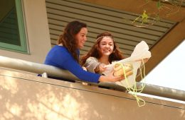 Foothill Seniors, Bridget Coonan and Amy Bradford, prepare to drop their egg-protecting contraption. Credit Aysen Tan/The Foothill Dragon Press