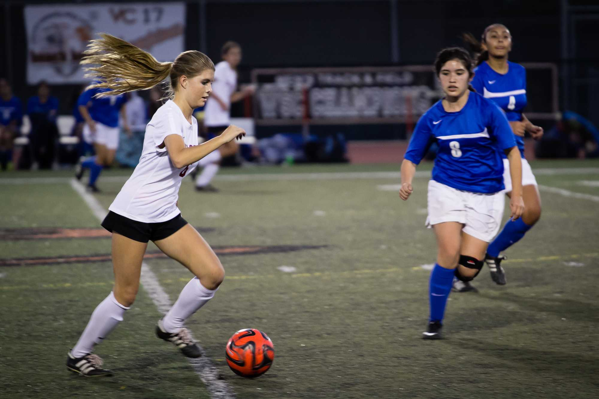 Sophomore Sidney Shinsky tries to run past Fillmore players. Credit: Josh Ren/The Foothill Dragon Press