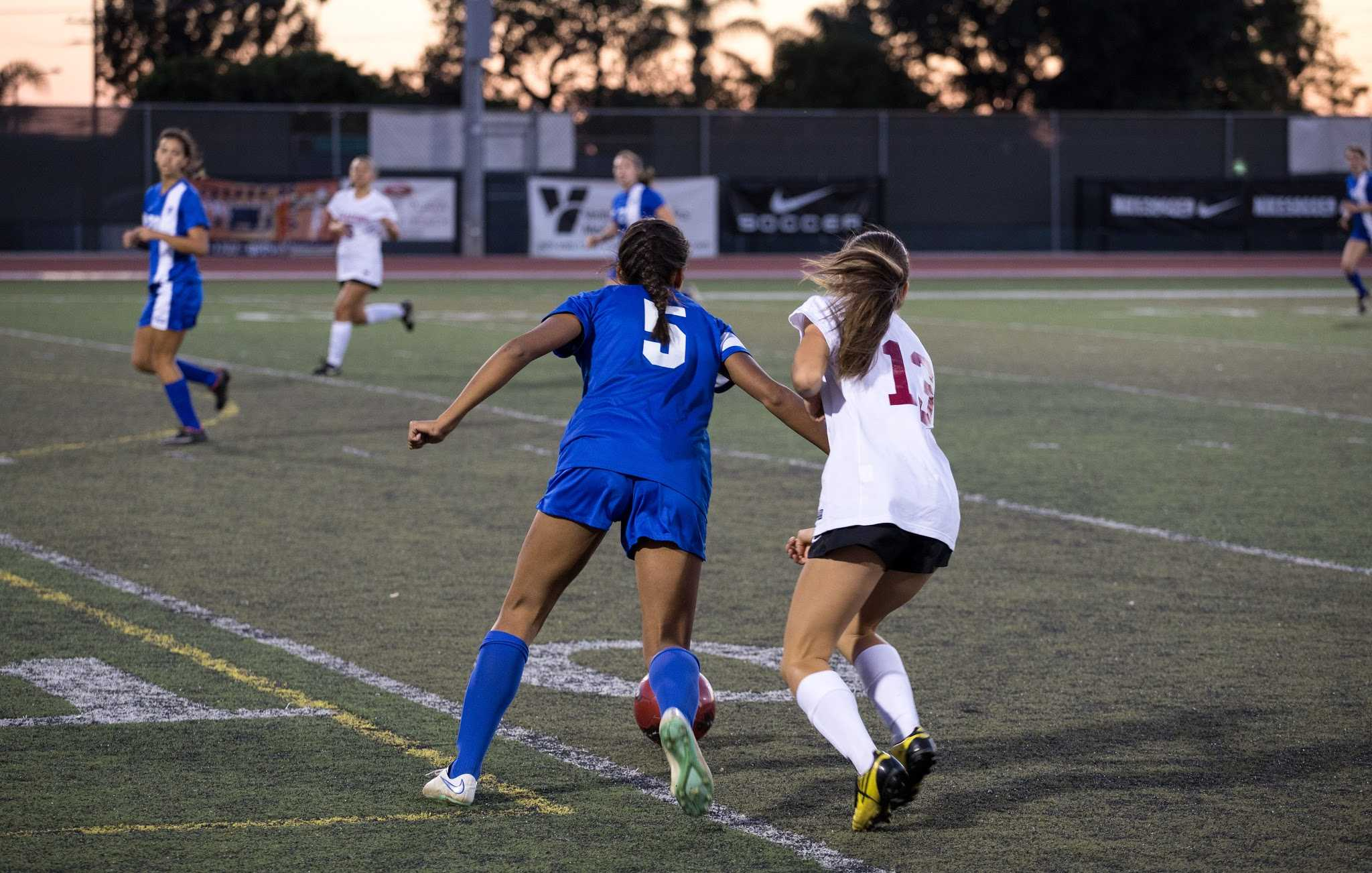 Skylar Rodriguez defends an opposing Cate high school player. Credit: Austin Hunt/ The Foothill Dragon Press