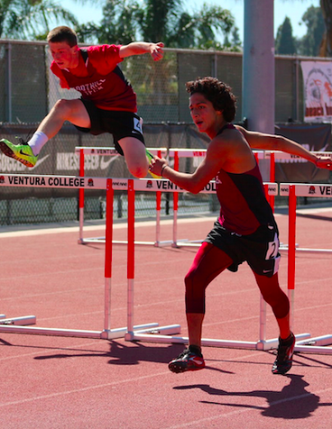 Freshmen Nathaniel Russell (left) and Erick Grewe (right) compete in the hurdles. Credit: Sarah Kagan/The Foothill Dragon Press