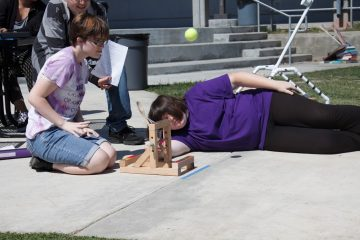 Sophomore Natalie Eberle catapults the tennis ball as part of the conceptual physics class project. Credit: Grayson McCoy/The Foothill Dragon Press