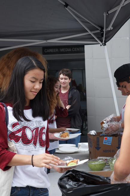 Senior Sachi Tan enjoys a Corrales burritos with other seniors before beginning team bonding activities. Credit: Julie Knowles/The Foothill Dragon Press