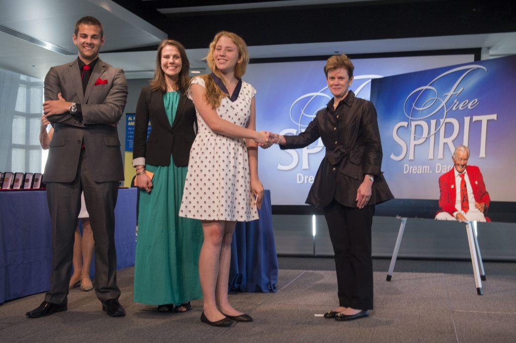 The Neuharth family and Fidelity during the Free Spirit graduation ceremony. Photo courtesy of the Newseum.