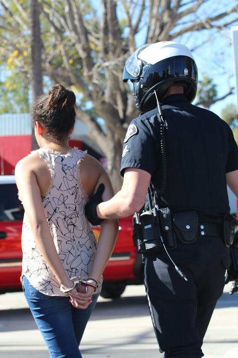 Junior Rhiannon Tircuit portrayed the drunk driver that was arrested and taken off of campus during Monday's Every Fifteen Minutes simulation. Credit: Carrie Coonan/The Foothill Dragon Press