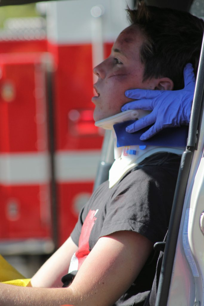 "Senior Michael Vaughan, who portrayed the driver that received minor injuries during the simulation, said that the experience was ""a lot more realistic"" than he expected it to be. Credit: Rachel Horiuchi/The Foothill Dragon Press"