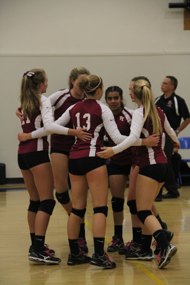 The players meet during Tuesday's game to pump each other up. Credit: Claire Dinkler/The Foothill Dragon Press