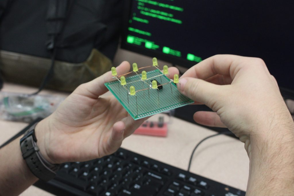 Senior Blake McAlister created this circuit  with LED lights. McAlister coded the microprocessor that displays a light show. Credit: Gabrialla Cockerell/ The Foothill Dragon Press