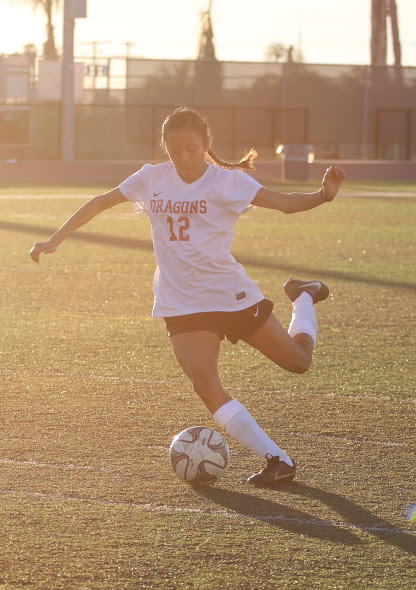 Junior Ada Tadeo prepares to kick the soccer ball. Credit: Grayson McCoy/The Foothill Dragon Press