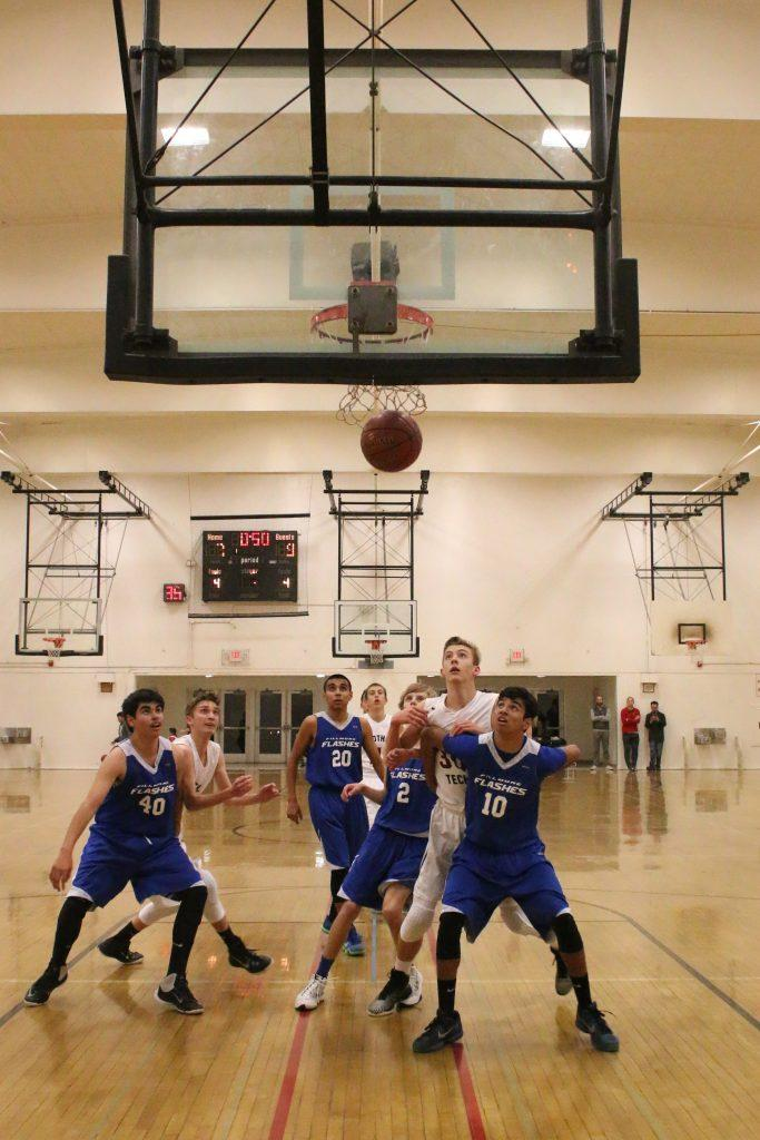 Fillmore holds Foothill players back after the Dragons score a basket. Credit: Grace Carey/The Foothill Dragon Press