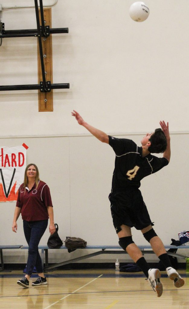 Junior Ian Overton serves the ball to the Hueneme team. Credit: Sarah Kagan/The Foothill Dragon Press