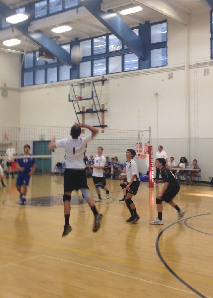 Sophomore Chad Talaugon jumps to spike the ball. Photo Credit: Chad Talaugon / The Foothill Dragon Press.