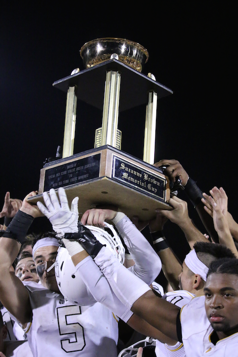 The trophy stays with the Cougars. Credit: Grace Carey / The Foothill Dragon Press.