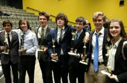 Debaters that won all three of their rounds. From right to left,