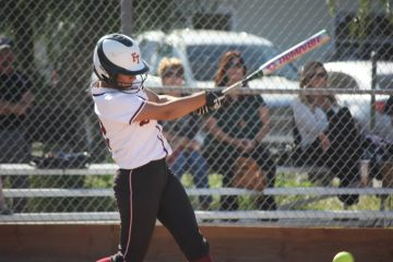 Junior Taylor Wreesman (12), with a stroke of her bat, gets ready to sprint to first base.  Credit: Gabrialla Cockerell/ The Foothill Dragon Press