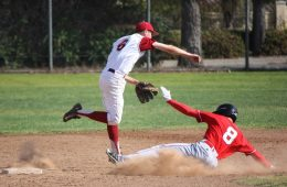 Foothill varsity succeeds in getting out rival batter, with senior Dillon Gallagher 6' playing second base. Credit: Gabrialla Cockerell/ The Foothill Dragon Press