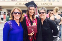 Gatlin with her parents. Reprinted with permission from Adriana Doyle.
