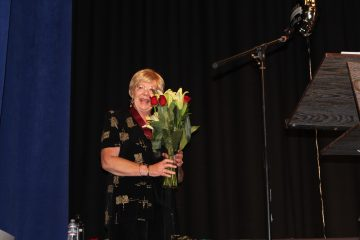 Linda Kapala receives a bouquet of flowers to honor her service at Foothill before retiring at Senior Awards Night. Credit: Jocelyn Brossia / The Foothill Dragon Press