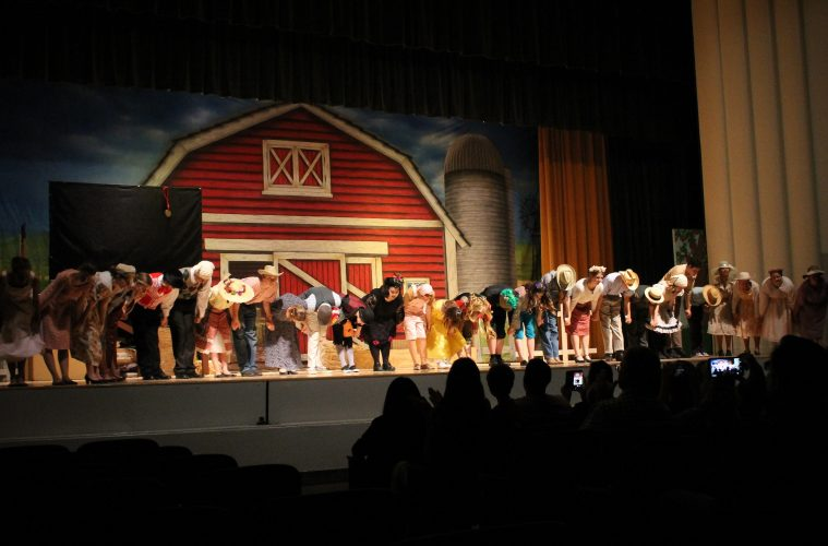The cast takes a bow at the end of the show. Credit: Claire Renar / The Foothill Dragon Press