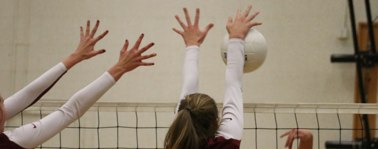 Morgan Gallagher '18 has both hands up to block opponent. Credit: Olivia Sanford / The Foothill Dragon Press