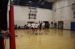 Girls' varsity cheers together after winning their CIF playoff game. Credit: Gabrialla Cockerell / The Foothill Dragon Press