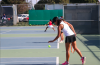 Sherlyn Khouvilay '18 bounces the ball before serving.  Credit: Olivia Sanford / The Foothill Dragon Press