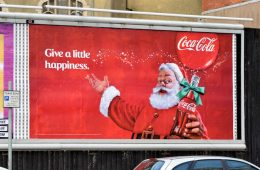 "Credit: ""Coca-Cola Christmas poster, Belfast (December 2014)"" by Albert Bridge is licensed under CC BY-SA 2.0"