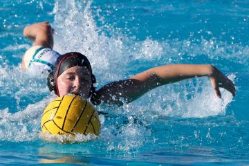 Sydney Roman '19 swims towards the ball. Credit: Abigail Massar / The Foothill Dragon Press