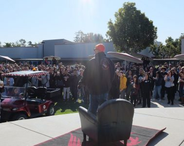 Dana Eaton stands before the crowd of students and teachers at the ceremony honoring him. Credit: Grayson McCoy / The Foothill Dragon Press