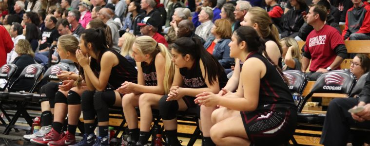 The girls watch their teammates from the sidelines. Credit: Riyanna De La Rosa(used with permission)