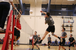 Collin Weaver '18 swings across the net hoping for a kill. Credit: Jason Messner / The Foothill Dragon Press