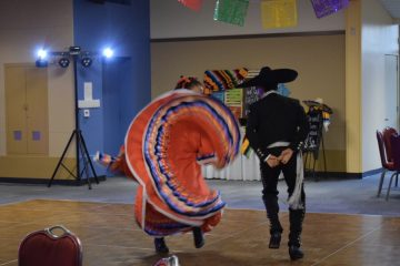 Maddie Espinoza '20 flows with the rhythm of the music while dancing ballet folklórico. Credit: Patricia Espinoza (used with permission)