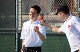 Devin Franke '21 and Tomas Carrillo '21 fist bump after scoring during their doubles.  Credit: Gabrialla Cockerell / The Foothill Dragon Press