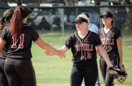 Jamie Dietz '19 and Jade Iannacone '18 high five at the top of the inning before they play outfield.  Credit: Gabrialla Cockerell / The Foothill Dragon Press.