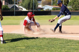 Gage Corsi '19 slides into third base, dodging a tag. Credit: Jason Messner / The Foothill Dragon Press