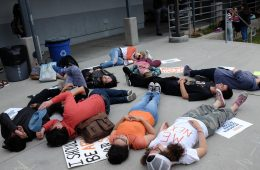 Hannah Yale '18 and fellow students lay in solace for the 10 students killed in Santa Fe. Credit: Grayson McCoy / The Foothill Dragon  Press