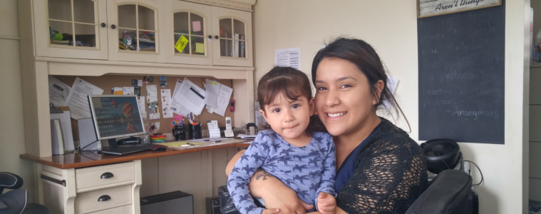 Amy Medina with daughter Alina in City Center office. Credit: Jack Vielbig / The Foothill Dragon Press