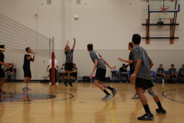 Kyle Cobian '18 sets the ball. Credit: Jason Messner / The Foothill Dragon Press