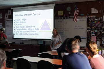 Health and psychology teacher Heather Ferris explains what her health class has planned for the upcoming year to the parents. Credit: Muriel Rowley / The Foothill Dragon Press