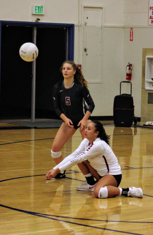 Haley Higgins '19 dives to pass the ball as Grace Brethren hits it over. Credit: Ethan Crouch / The Foothill Dragon Press