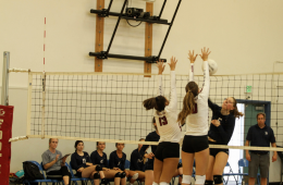 Haley Higgins '19 and Lexi Donelly '21 jump to block a hit. Credit: Ethan Crouch / The Foothill Dragon Press