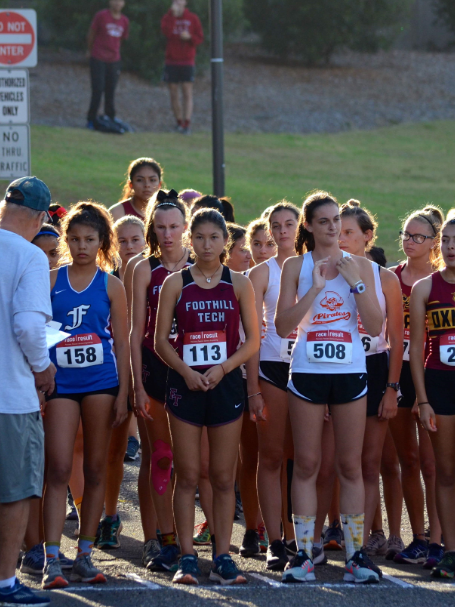 Runners line up at the start for the girls' three mile race. Credit: Jill Kinnaman (used with permission)
