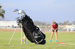 Player hits a golf ball. Credit: Claire Renar / The Foothill Dragon Press