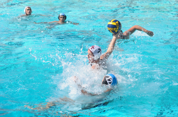 Nikolai Haynes '20 swerves the opponent. Credit: Muriel Rowley / The Foothill Dragon Press