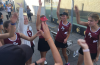 The girls' tennis team huddles at their match. Credit: Abby Sourwine / The Foothill Dragon Press