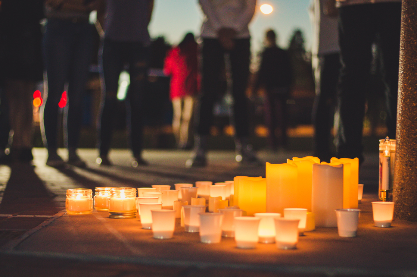 Citizens of Ventura, Ca. circle around the candle lit alter outside of the Government Center. Credit: Stefan Fahr / The Foothill Dragon Press