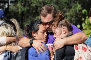 Cal Lutheran staff member hugs devastated students. Credit: Olivia Sanford / The Foothill Dragon Press