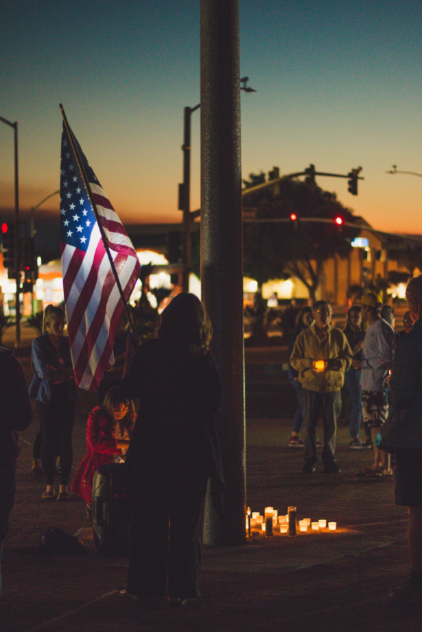 Aside from the candle lit vigil, Ventura residents brought a United States flag. Credit: Stefan Fahr / The Foothill Dragon Press