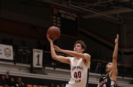 Ian Ingram '19 reaches for the layup. Credit: Jason Messner / The Foothill Dragon Press