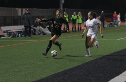 Grace Combs '20 sprinting down the field with the ball. Credit: Olivia Sanford / The Foothill Dragon Press